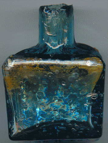 aqua glass victorian ink bottle with original broken-off neck and many many bubbles: back view