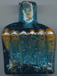 aqua glass victorian ink bottle with original broken-off neck and many many bubbles: front view