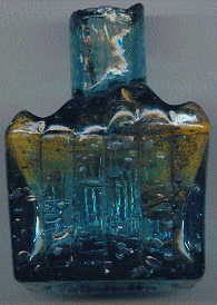 aqua glass victorian ink bottle with original broken-off neck and many many bubbles: left view