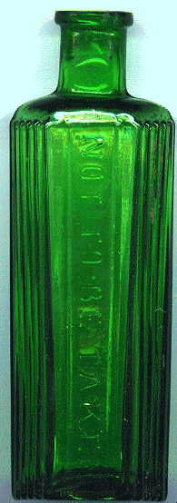 hexagonal green poison bottle: front view with raised letters and ribbed sides