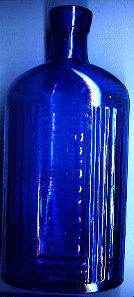 large blue victorian poison bottle.  it says, POISONOUS. NOT TO BE TAKEN.