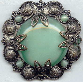 1940s? brooch with green satin glass cabochons