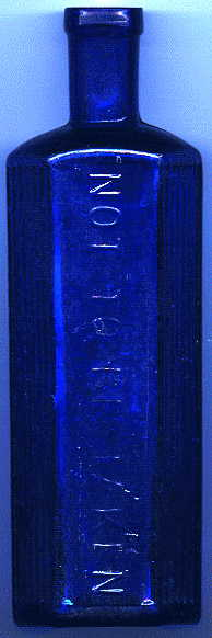 medium-large bristol blue victorian poison bottle. it says: NOT TO BE TAKEN